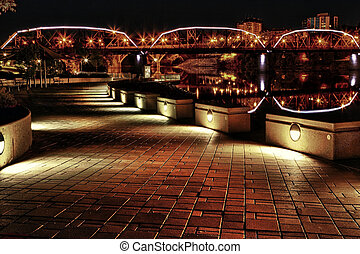 Sidewalk lit up along river - Path along the South...