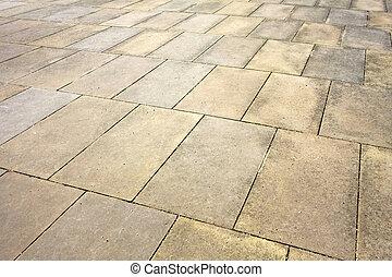 Angle shot of sidewalk pavement plates texture