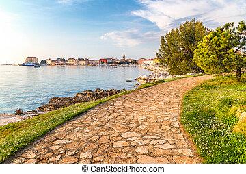 Sidewalk to Porec town on Adriatic sea in Croatia, Europe.