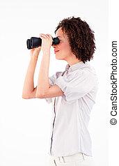 Sideways portrait of businesswoman with binoculars