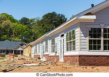 Siding and Windows on New Row House Construction
