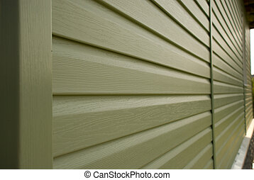 Siding wall of building in perspective closeup in the...