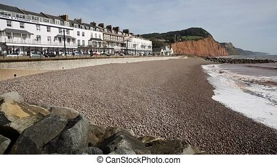 Sidmouth shingle and pebble beach and waves Devon England UK...