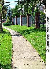 Sidwalk Winds Through Neighborhood - City sidewalk winding...
