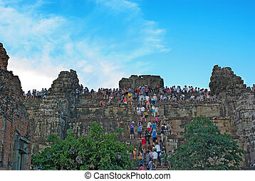Siem Reap , CAMBODIA - MAY 02: Unidentified tourists climbing to