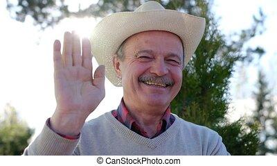 sien, main., onduler, dire, personne agee, revoir, chapeau, bonjour, homme