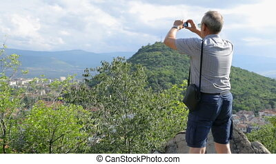 sien, smartphone, touriste prend photo