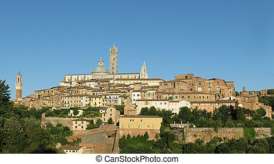 Siena, Italy - medieval city centre with town hall tower, cathedral and Santa Maria della Scala former hospital