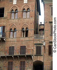 Siena - brick facades of Gothic buildings at Piazza Del ...