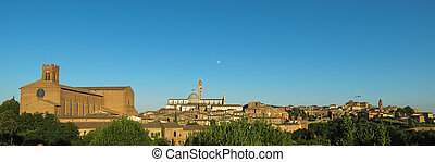 Siena cityscape with the curch of San domenico and the cathedral