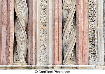 Siena - Details of the columns in marble on the facade of the Baptistery