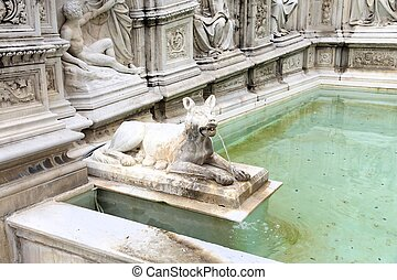 Siena, Italy - medieval town of Tuscany. Fonte Gaia - fountain at Piazza del Campo.