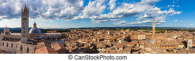 Siena, Italy panorama rooftop city view. Siena Cathedral and Mangia Tower