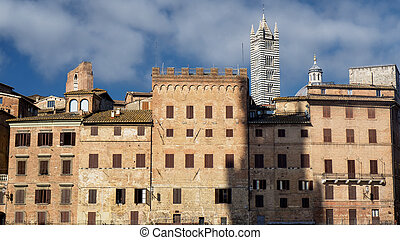 Historic buildings in Piazza del Campo in SIena, Tuscany, Italy, the famous square hosting the Palio, at morning