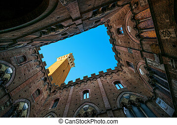 Siena landmark photo. Cortile del Podesta and Mangia tower....