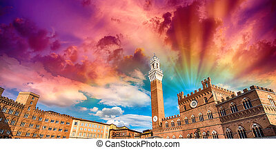 Siena, Piazza del Campo. Famous italian square with dramatic sky.