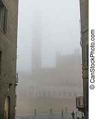 Siena, Italian medieval town - Piazza del Campo covered with fog