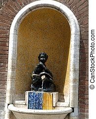 Siena - spring with a lovely statue of a Negress in the streets in the historic city center