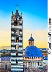 Siena sunset, Cathedral Duomo and Campanile tower landmark. Tuscany,