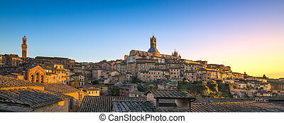 Siena sunset panoramic skyline. Mangia tower and cathedral...