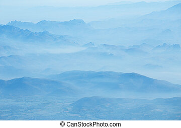 mountains under mist in the morning.