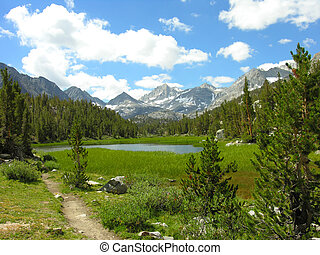 Sierra Nevada Lake - View of lake with mountains in the...