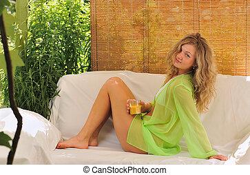 siesta - blond girl  resting  on sofa in  hot summer day