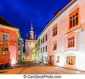 Sighisoara in Transylvania at night - clock tower and ...