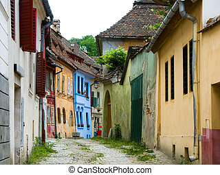 Medieval street view with houses in Sighisoara, saxon city in Transylvania, Romania