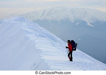 Alpinist contempling the view in Piatra Craiului Mountains, Romania.