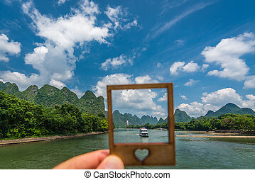 Sightseeing boat full of tourists on Li River