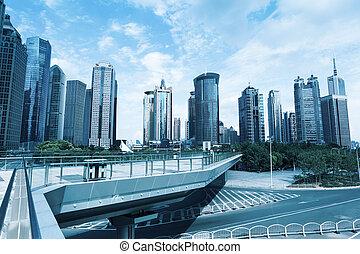 sightseeing footbridge in shanghai downtown,modern cityscape