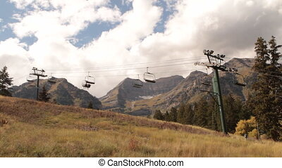 sightseers on chairlift in autumn