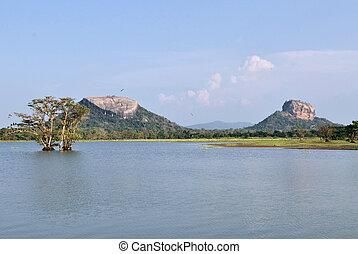 Sigiriya and Pidurungala Rock in Sri Lanka - Human made tank...