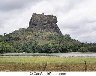 Sigiriya Rock on the beautiful island of Sri Lanka is famous...