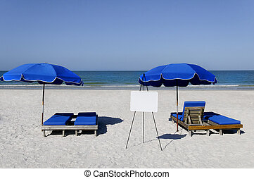 Sign and Blue Umbrellas - A blank whiteboard at the ocean...