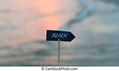 sign beach and Sunset