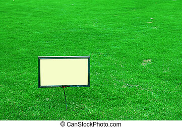 Sign board - A blank sign board on the green lawn