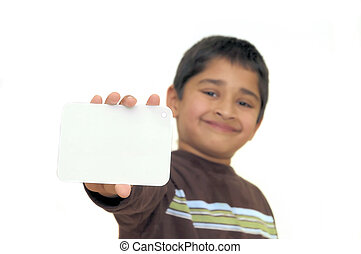An handsome Indian kid holding a signboard