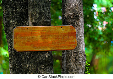 Sign board made from wood on tree