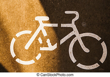 sign cyclist on the background of asphalt road.
