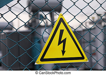 Sign dangerously electricity on an old grid