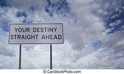 Highway road sign with the words YOUR DESTINY STRAIGHT AHEAD written on it with a time-lapse clouds background.