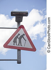 Sign elderly people crossing on the street.