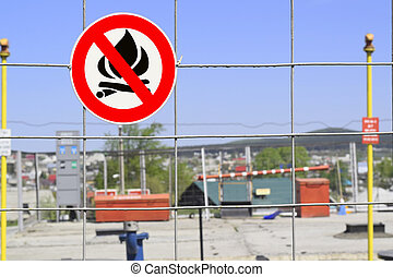 """Sign """"Flammable"""" on the fence"""