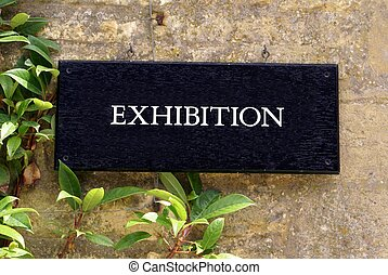 sign for an exhibition - sign direction the public or...