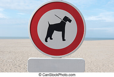 Sign for dog ban on the North Sea beach in Belgium