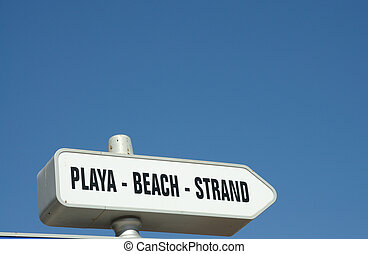 Sign for the Beach in three languages, spanish, english and german