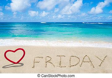 """Sign """"Friday"""" on the sandy beach"""