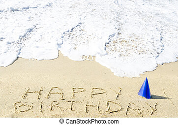 "Sign ""Happy Birthday"" on the sandy beach"